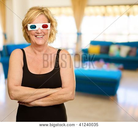 Happy Elderly Woman Wearing 3d Glasses Holding Popcorn And Ticket, Indoors