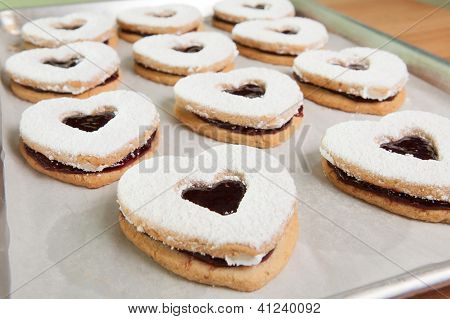 Baking tray of heart shaped cookies