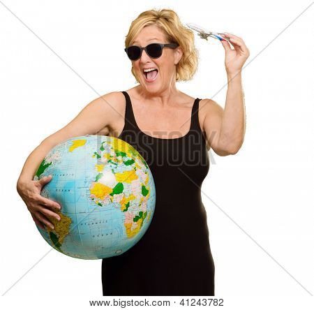 Mature Woman Holding Globe And Miniature Airplane On White Background