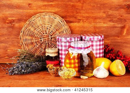Honey and others natural medicine for winter flue, on wooden background