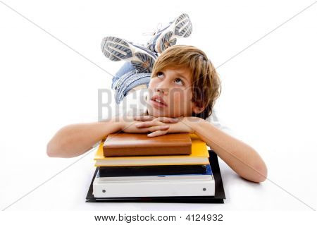 Front View Of Laying Boy With Books