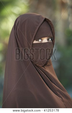 Side view of a veiled Indian woman