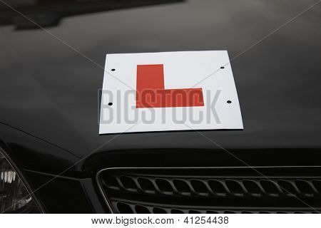 Red learner driver symbol on a car hood