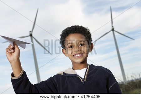An African American cute little boy playing with paper plane