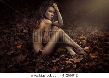 Sexy nude woman in nature scenery