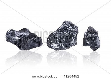 Three Pieces Of A Small Anthracite Coal, Isolated On White