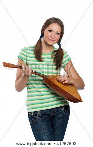 Beautiful teen girl with balalaika posing on white background