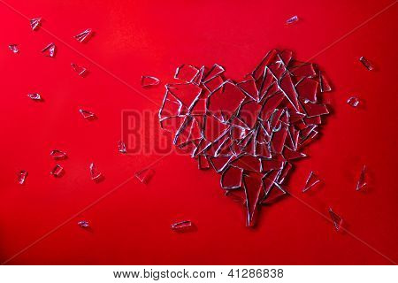 Glass Heart On Red Background