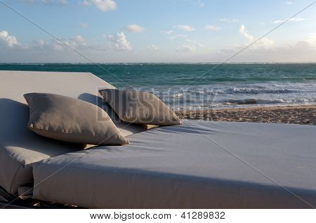 A Lounge for Two on a Beautiful Beach