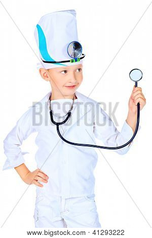 Portrait of a cute boy playing doctor with a stethoscope. Isolated over white.