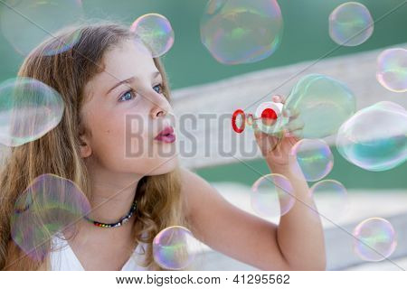 Summer joy - Soap bubbles - lovely girl blowing bubbles
