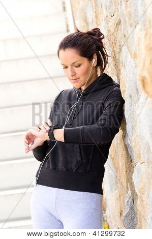 Young woman checking after exercising running sport mp3 sweatsuit