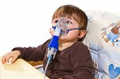 stock photo of breath taking  - a little child taking respiratory inhalation therapy - JPG