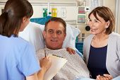 picture of ward  - Nurse Talking To Couple On Ward - JPG