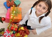 stock photo of party people  - Little girl and a lot of chirstmas gift boxes - JPG