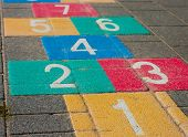 pic of hopscotch  - detail of a colorful hopscotch game on a schoolyard - JPG