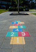 stock photo of hopscotch  - colorful hopscotch game on a schoolyard in the netherlands - JPG