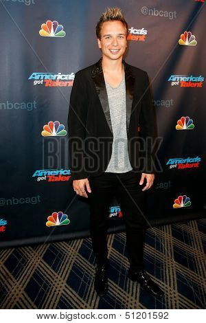 NEW YORK-AUG 28: Illusionist Leon Etienne attends the post-show red carpet for NBC's