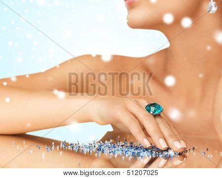 jewelry, luxury, bridal concept - woman's hand with cocktail ring on the mirror