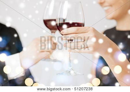 love, romance, holiday, celebration concept - engaged couple with wine glasses in restaurant