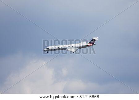 American Eagle Bombardier CL-600 plane in New York sky before landing in La Guardia Airport