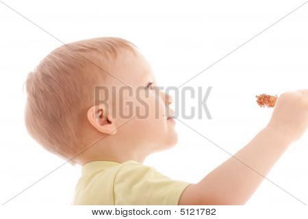 Portrait Of Joyful Boy Reach Sugar Candy