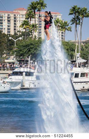 Unidentfied man demonstrates flyboard acrobatics in Long Beach