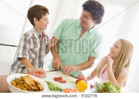 Father And Children Prepare A Meal, Mealtime Together