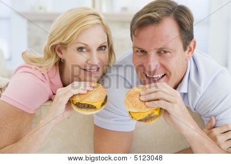 Couple Enjoying Burgers Together