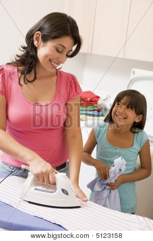 Mother And Daughter Ironing