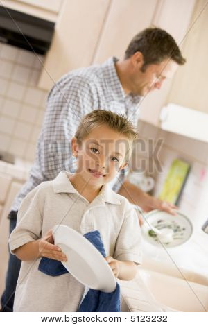 Father And Son Cleaning Dishes