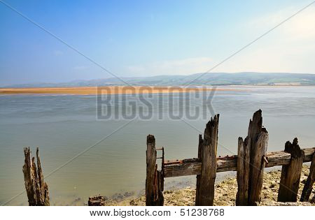 Wooden posts near Millom