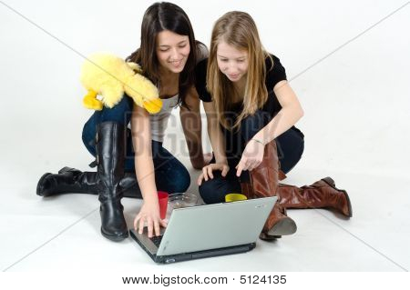 Young Girls Sitting On The Floor With Laptop