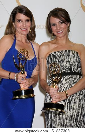 LOS ANGELES - SEP 22:  Tina Fey, Tracey Wigfield at the 65th Emmy Awards - Press Room at Nokia Theater on September 22, 2013 in Los Angeles, CA