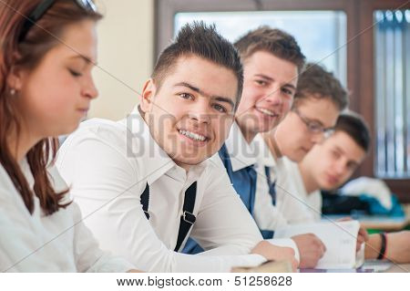 Cheerful students smiling in a schoolroom