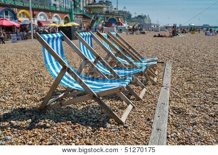 4 Deck Chairs On Brighton Beach