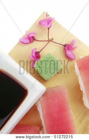 Nigiri Sushi - Set of Nigiri sushi topped with raw Tuna (maguro) . Isolated over white background . on wooden board