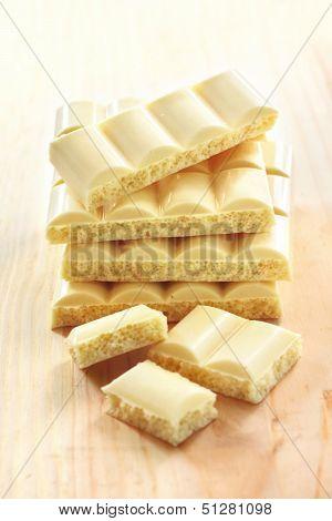 White Porous Chocolate On Wooden Background