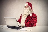stock photo of letters to santa claus  - Santa Claus working with the computer - JPG