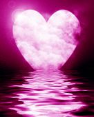 stock photo of soulmate  - Heart shaped moon reflected in ocean on a pink background - JPG