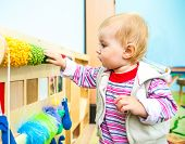 image of montessori school  - cute little boy in the classroom early development plays with  bright toys - JPG
