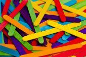 stock photo of popsicle  - A Rainbow of Colorful Popsicle Sticks Scattered - JPG