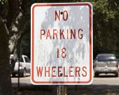 image of 18-wheeler  - No parking 18 wheelers sign in shade - JPG