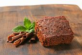 stock photo of brownie  - piece of brownie with chocolate curls and mint - JPG