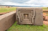 stock photo of pumapunku  - One of the megalithic stones with intricate carving in the complex Puma Punku - JPG