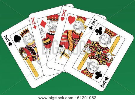 Four Kings playing cards on a green background