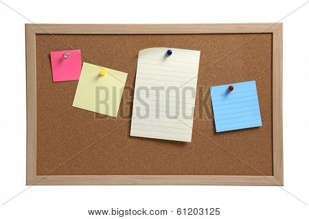 Cork board with blank colored notes and pins on white background