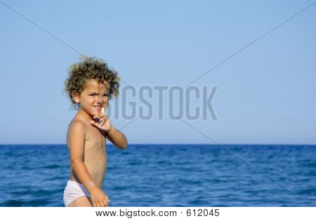 Young curios boy with a finger in his mouth
