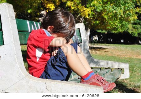 Sad Child In The Park, Outdoor, Summer To Fall