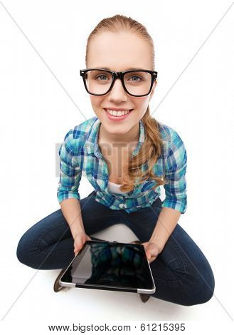 happiness, technology, internet and people concept - smiling young woman in casual clothes sitiing on floor with tablet pc computer